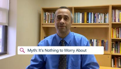 Dr. Simon Rego, Chief Psychologist, sitting in an office discussing the myth that COVID-19 is nothing to worry about.