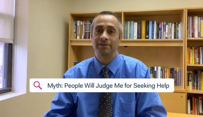 Dr. Simon Rego, Montefiore's Chief Psychologist, sitting in an office discussing the myth about judgement and COVID-19.