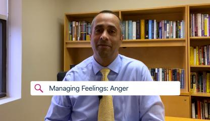 Dr. Simon Rego, Montefiore's Chief Psychologist, sitting in an office discussing feelings of anger toward COVID-19.