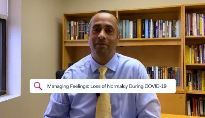 Dr. Simon Rego, Montefiore's Chief Psychologist, sitting in an office discussing feelings of loss of normalcy during COVID-19.
